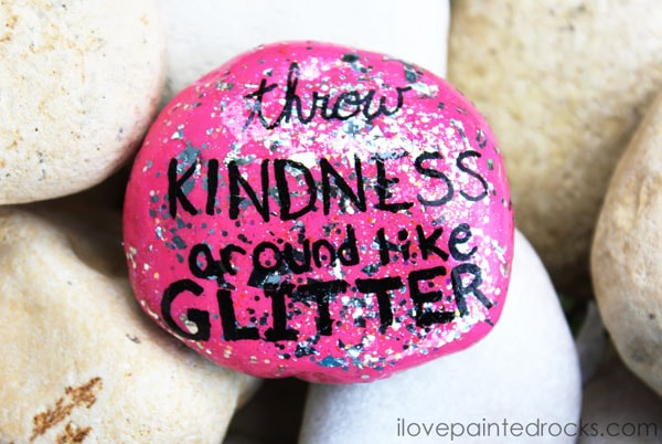 painted rock with glitter- kindness rock that says throw kindness around like glitter