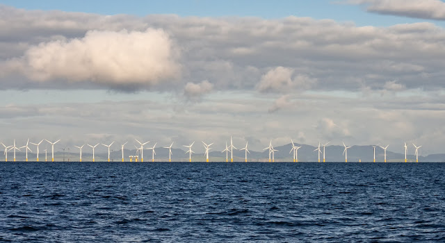 Photo of Robin Rigg Wind Farm taken from a lot closer than we  usually get to it
