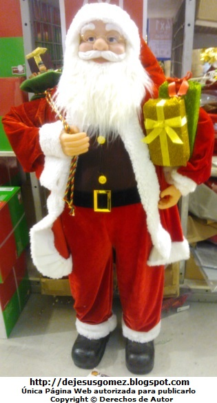 Foto de Papa Noel con regalos por Jesus Gómez