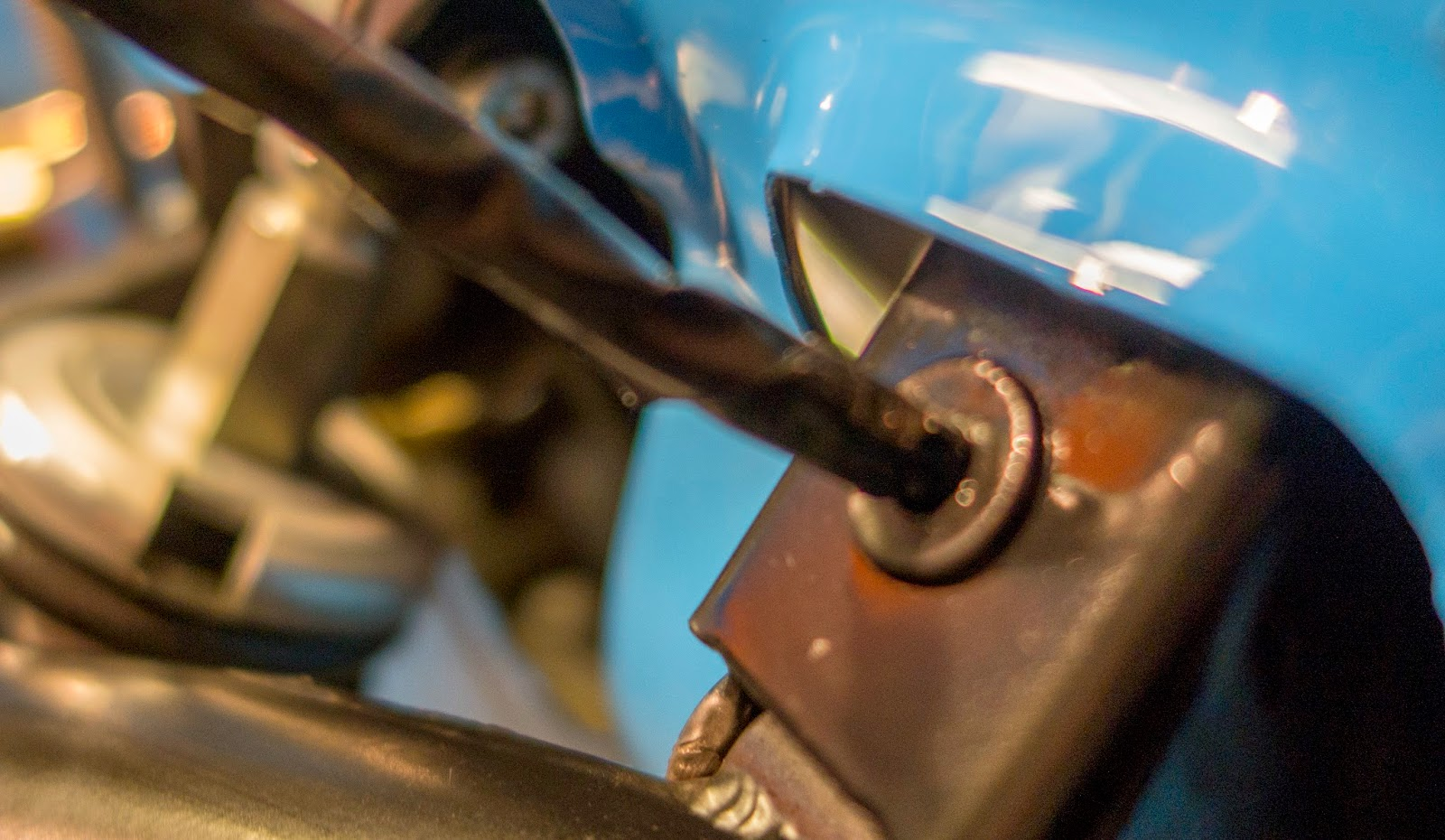 Feed headlight wiring through grommet
