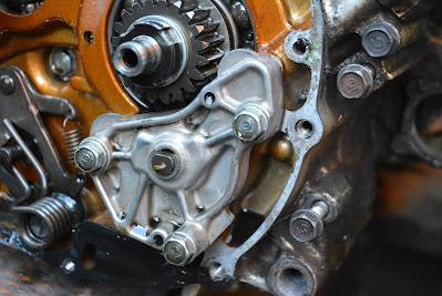 Honda CBR 125 R Clutch side cover removal , clutch side engine strip down ( oil pump gear selector shaft )