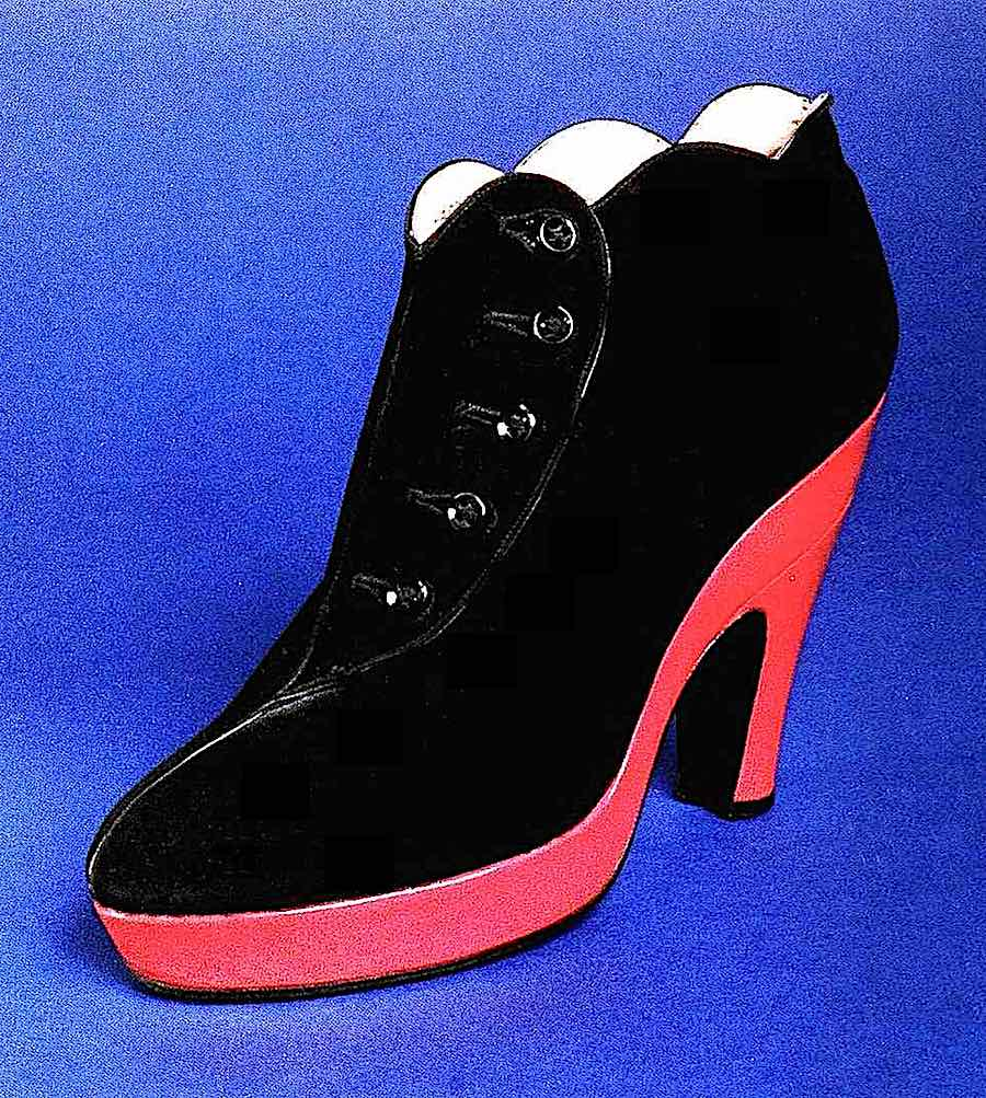 a 1939 designer shoe in black and red, a color photograph