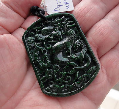 beautiful carved black pendant