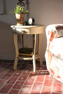 painted brick floor with table