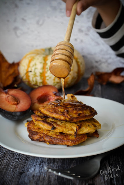 pile of paleo pancakes flavoured with warm spices, drizzled with honey