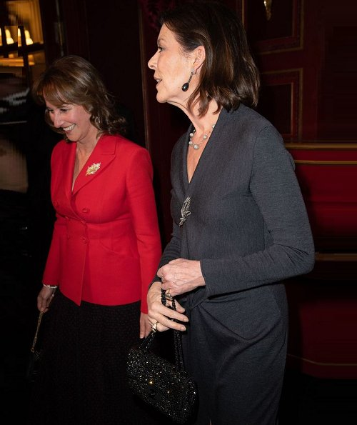 The Princess attend a party at Le Grand Hotel in Paris. Princess Caroline of Monaco wore a gray maxi dress by Prada