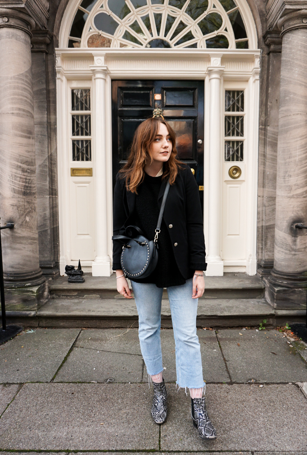 autumn 2018 outfit featuring black blazer, jumper and cross body bag, with light blue cropped jeans and snake print ankle boots