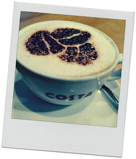 Polaroid-stylised photo of a cup of Costa coffee