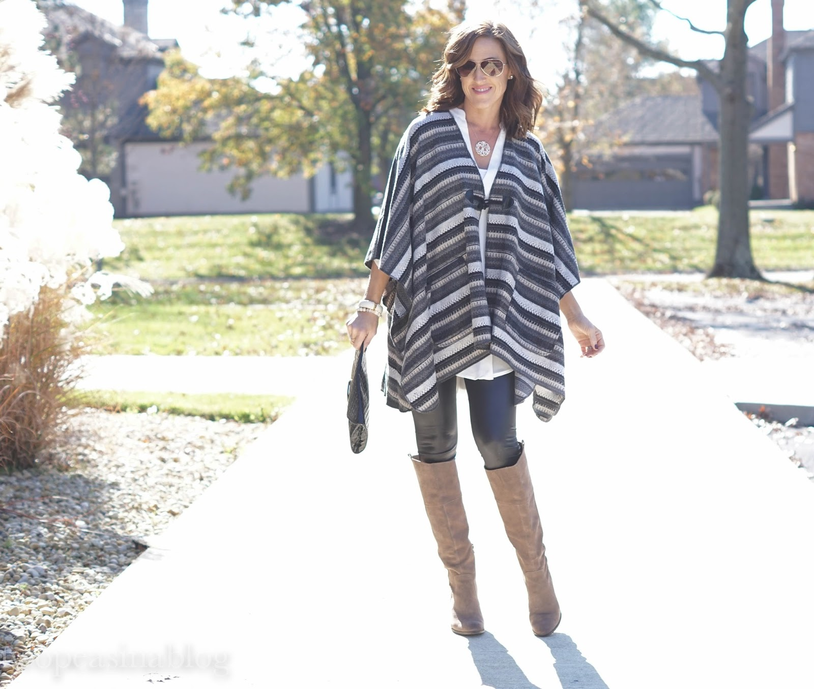 4ca749ae0d616c Pair them with something over-sized like an adorable poncho or long  sweater. Adding knee-high boots can also help you ease into wearing leather  leggings as ...