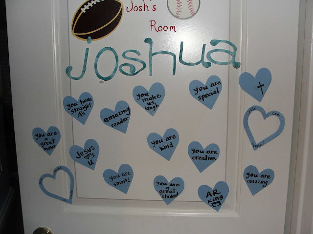 decorate your children's doors with hearts and why you love them on Valentine's Day
