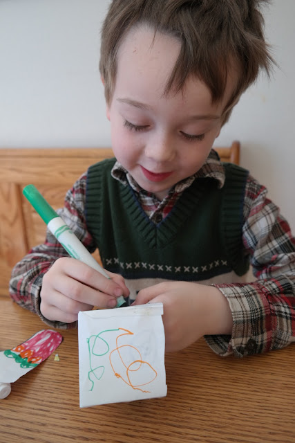 Photo of the author's son doing the Letter X Christina Katerina & The Box drawing activity