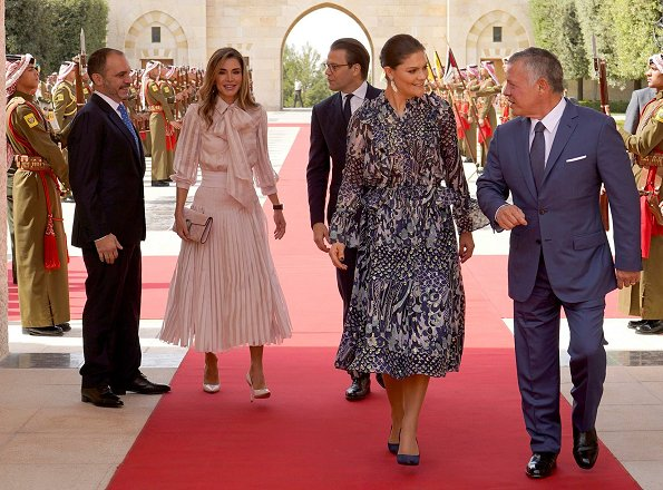 Crown Princess Victoria wore Samsøe&Samsøe Joanna ss shirt and Cathy skirt and By Malene Birger pumps. Queen Rania