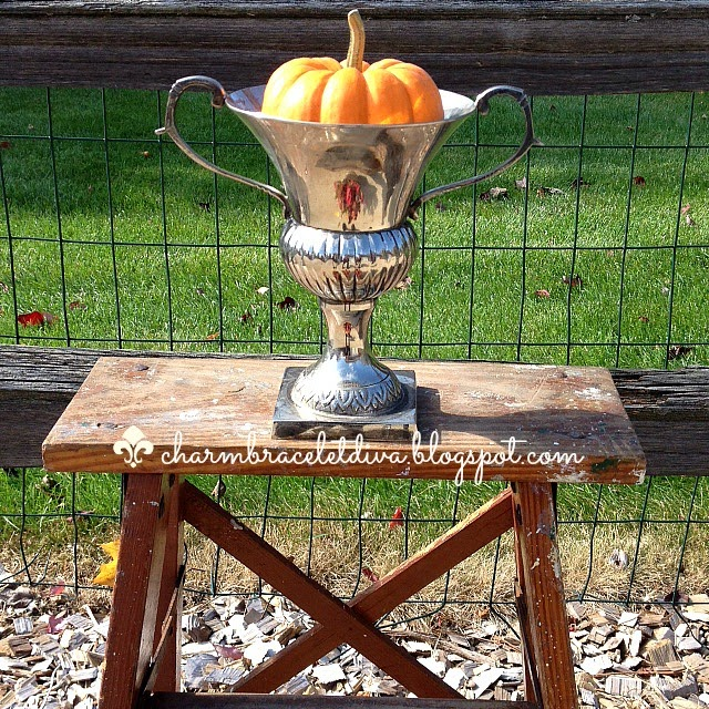 estate sale silver loving cup with baby boo pumpkin