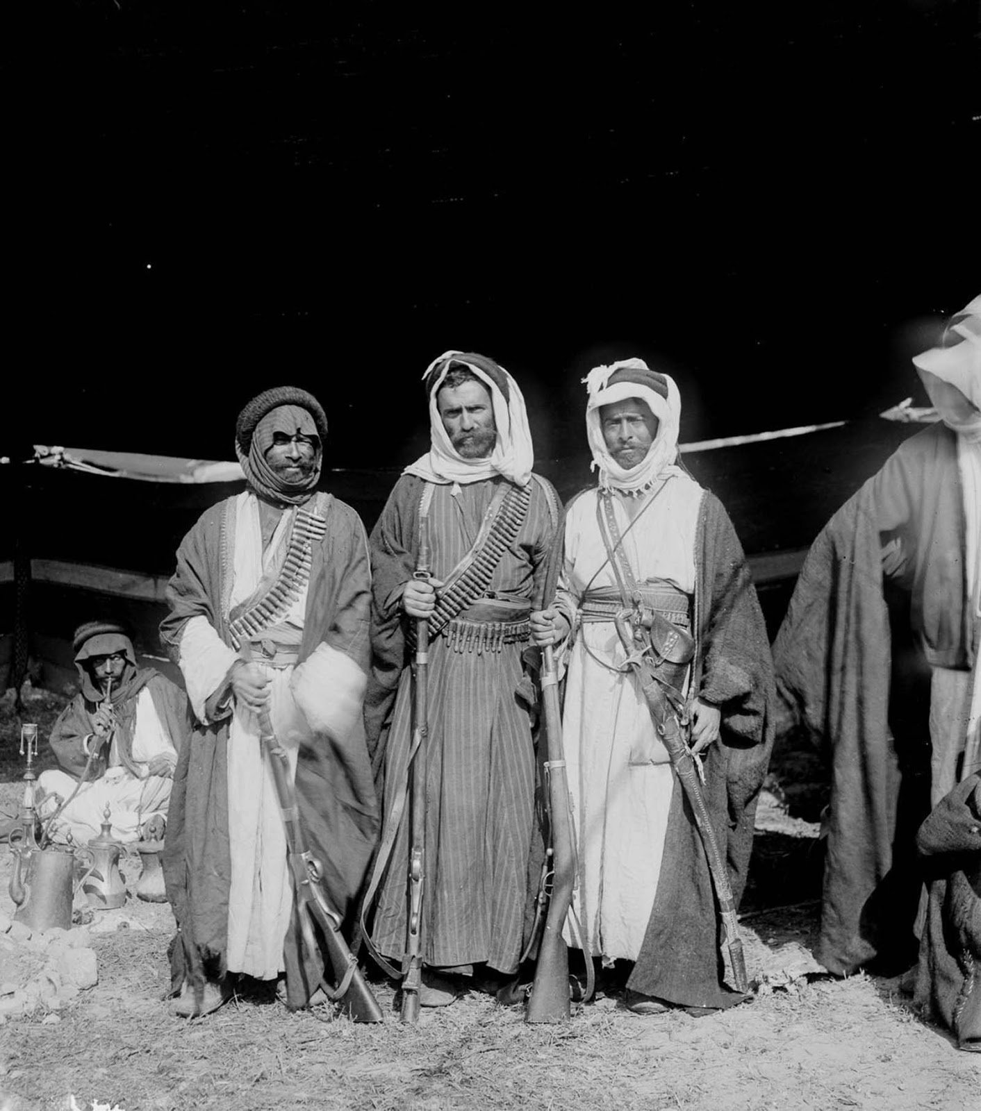 Armed Bedouin men.