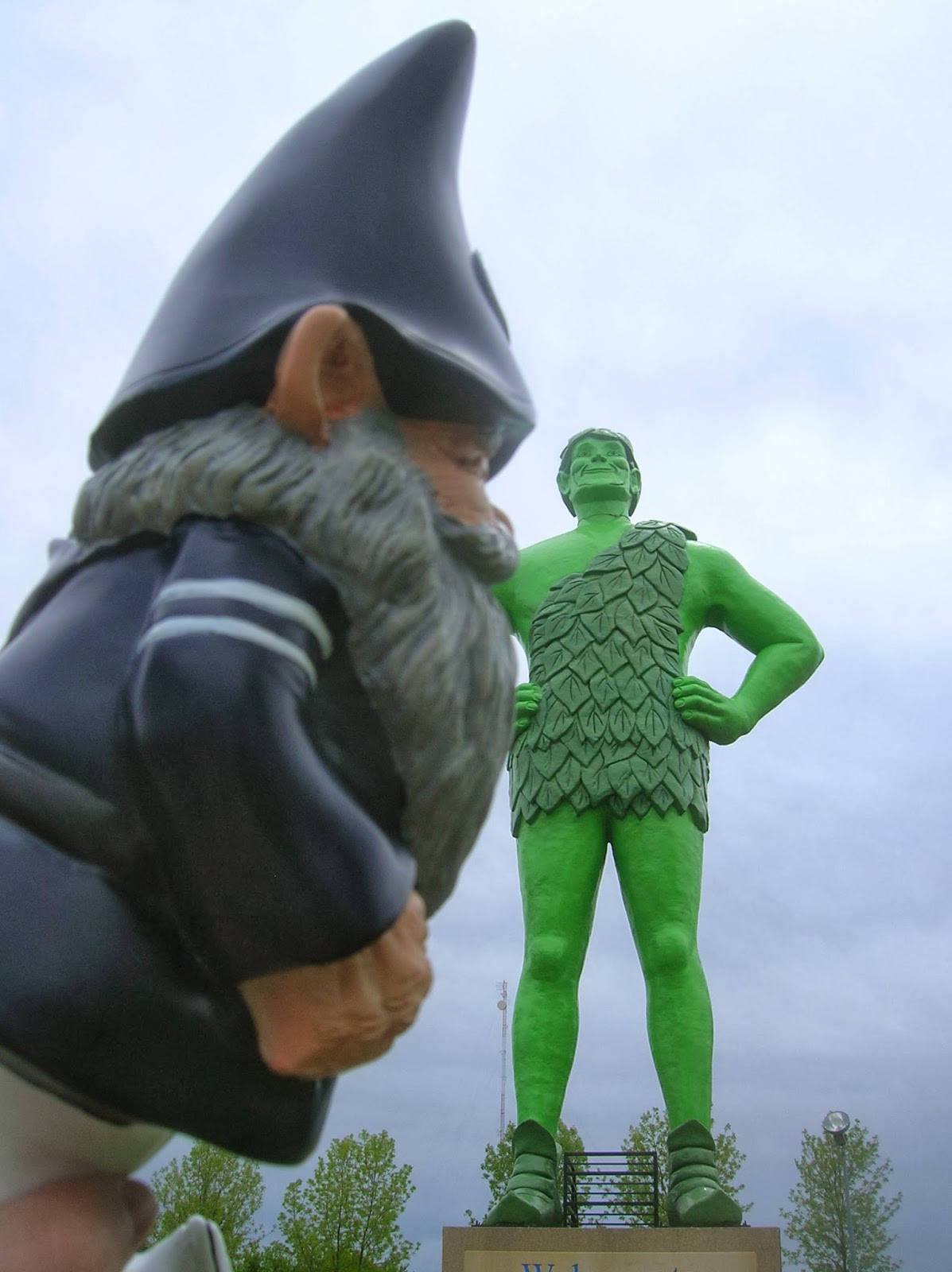 Penn State Gnome kissing the jolly green giant