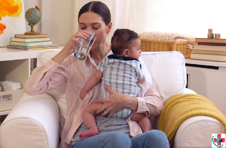 Breastfeeding mom drinking water