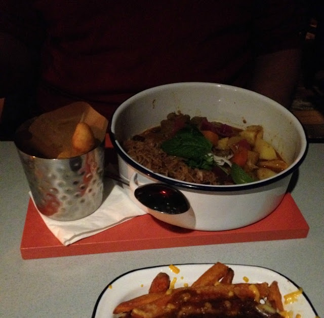 picture of curry in a bowl and chips