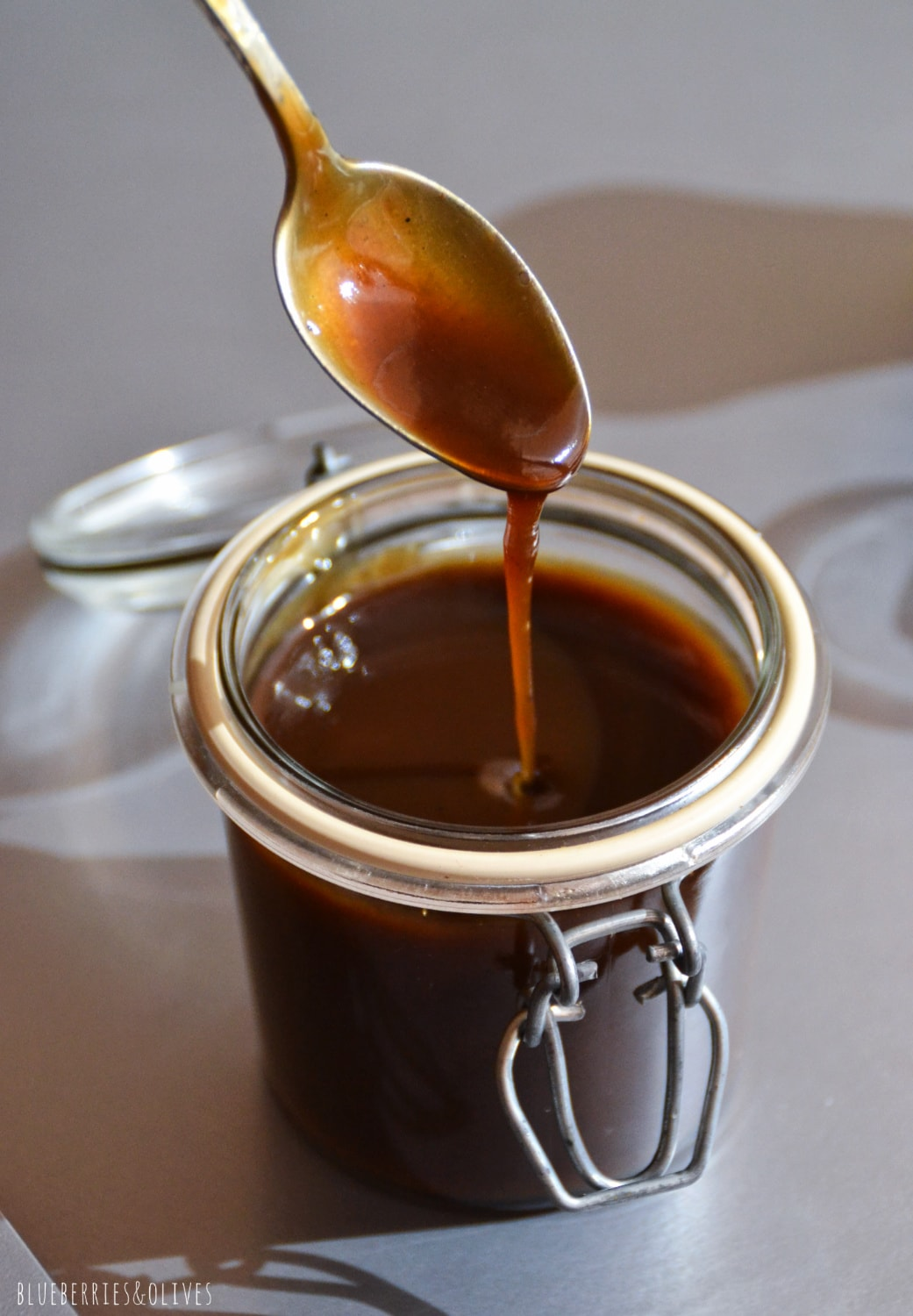 SALTED CARAMEL DRIZZLING FROM SPOON TO JAR