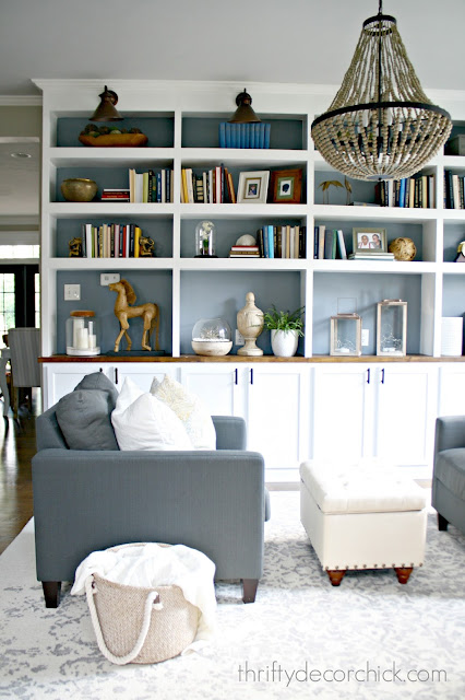 wall of DIY bookcases using kitchen cabinets