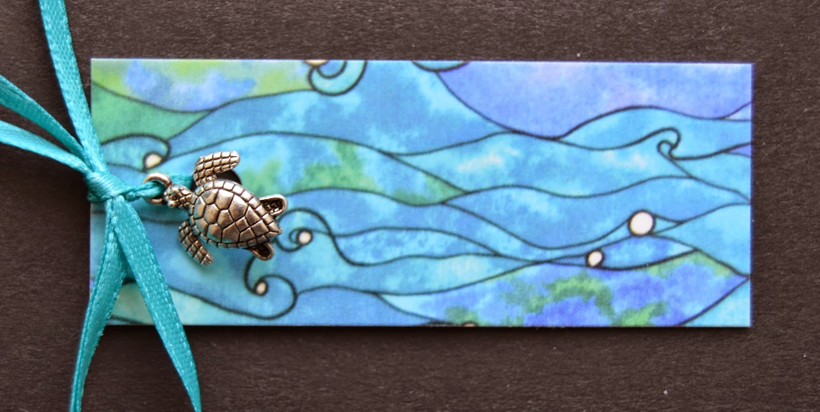 turtle charm as part of the packaging from Ocean Patch Etsy shop