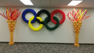 Sport theme balloon decor.  Rio de Janeiro Olympic 2016 balloon rings and balloon torches