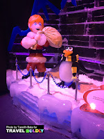Santa Claus & his penguin  side-kick Topper. ICE at the Gaylord Texan Resort, Grapevine, Texas. Travel Boldly