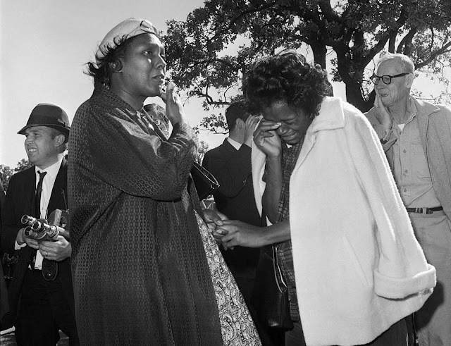 Women burst into tears outside Parkland Hospital upon hearing that President John F. Kennedy died from a gunshot wound while riding in a motorcade in Dallas, on November 22, 1963.