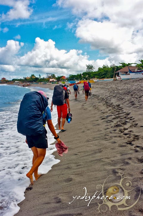 Mountaineers trekking the sandy beach of Pundaquit hover_share