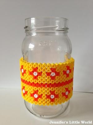 Hama beads wrapped around a jam jar