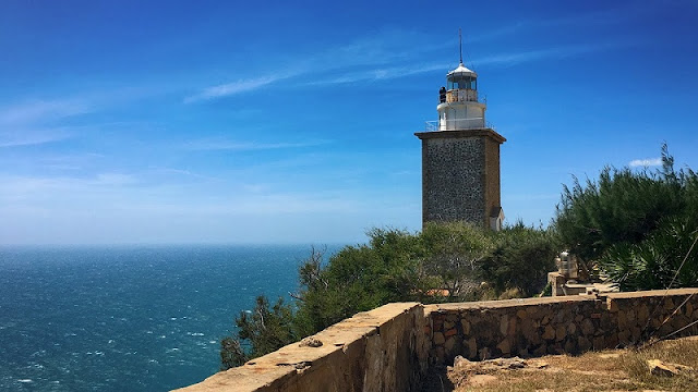 White sand dunes, a lighthouse and a solitary beach experience 2