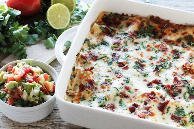 Spicy Bacon Lasagna with onion, jalapeno, and cilantro. Top it off with a fresh avocado salsa for a spic spin on classic lasagna. And, hello! Bacon!