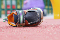 Image of a single child's shoe on it's side: Child Lost