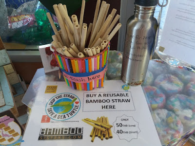 Photo of bamboo straws placed upon a table made by eco-bricks