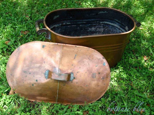 Antique copper pot with lid is not in perfect condition, but still perfect for firewood