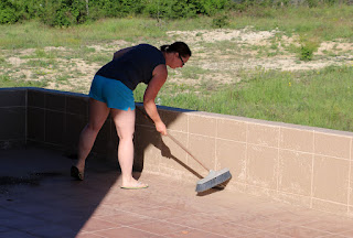 Sweeping up the dust on the balcony
