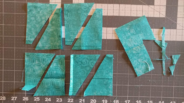 Batiks and solids for a modern Teal Mini Swap Quilt