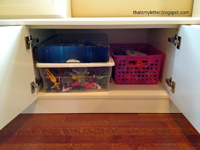 Ikea cabinet built ins with toy storage bench