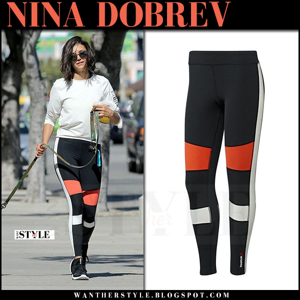 Nina Dobrev in white sweatshirt and black colorblocked leggings reebok what she wore april 28 2017