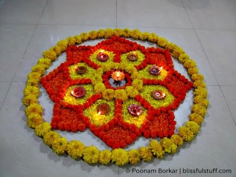 Diwali Special Rangoli Design with marigold flowers and diya How to make rangoli with flowers