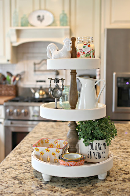 3 tiered kitchen stand from HomeGoods on kitchen island. More ideas for tiered stands in this post.