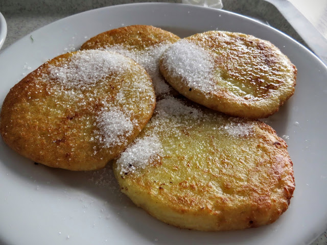 Potato pancakes with sugar in Warsaw, Poland