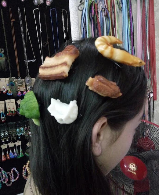 Girl wearing food hairpins