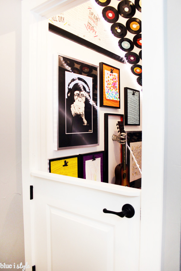 Music themed under stairs playroom with DIY dutch door