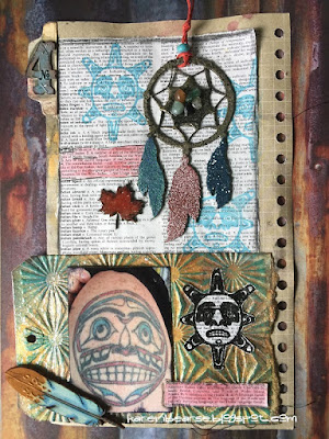 A colorful art journal with photo of Haida Sun tattoo, stamps of the image and a chipboard painted dreamcatcher.