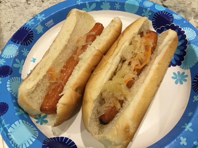 two roasted carrot hot dogs in hot dog buns