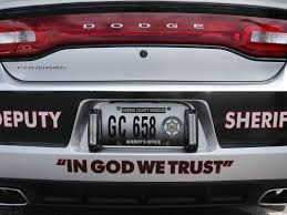 http://www.foxnews.com/us/2015/07/26/missouri-sheriff-puts-in-god-trust-decals-on-patrol-cars/?intcmp=hplnws