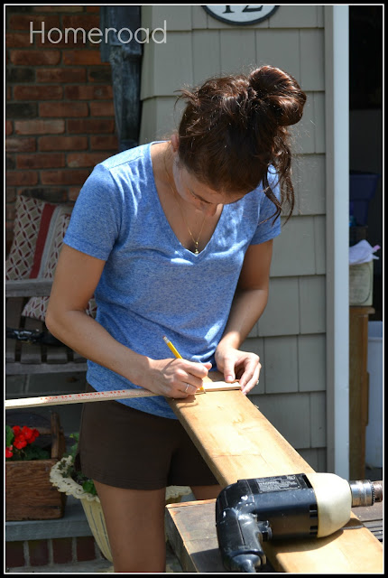 Woman measuring wood