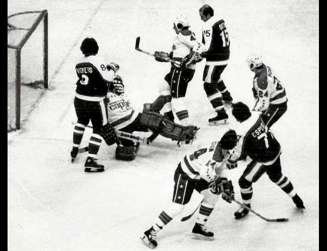 Vs. NY Rangers (Book Pg. 102): Phil Esposito (77) on offense against goalie Bernie Wolfe and mates Larry Bolonchuk (4), Gerry Meehan (14), and Robert Picard (24)