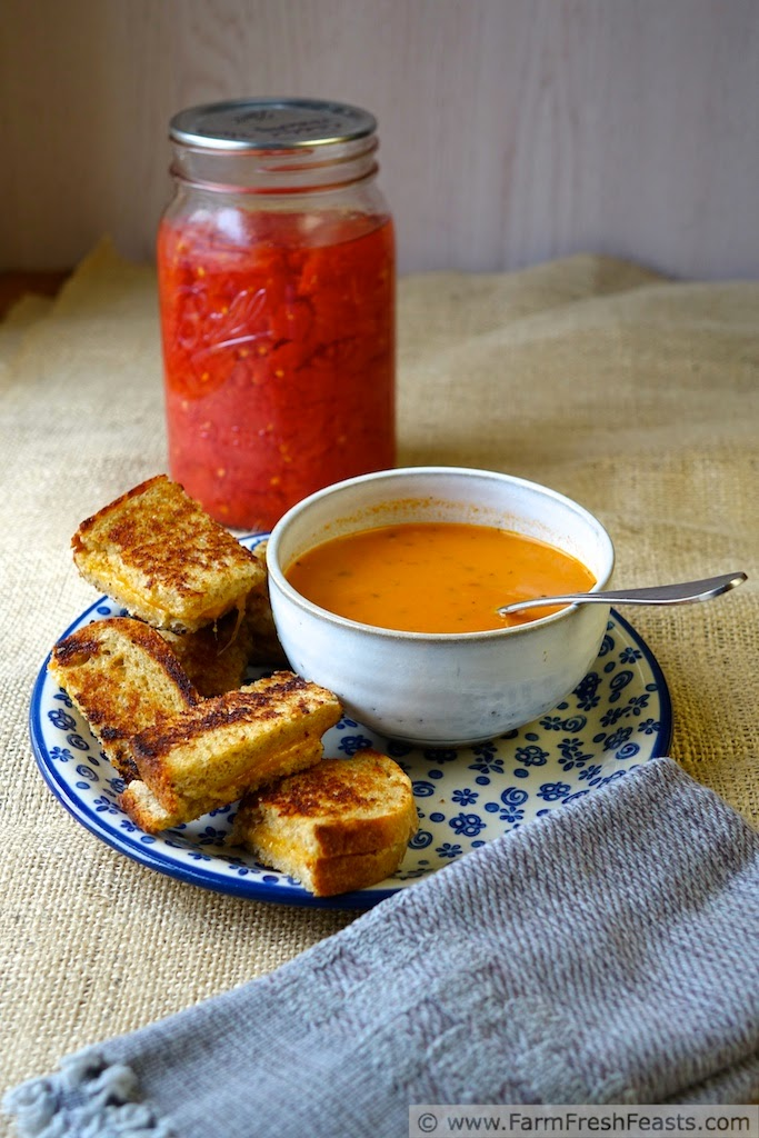 A creamy tomato soup made with home-canned tomatoes, pesto, and roasted garlic.