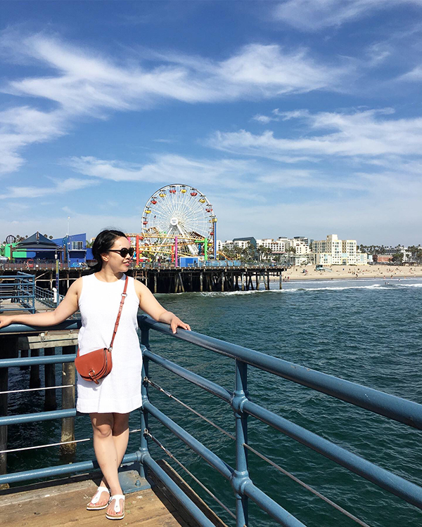 Posing on the Santa Monica pier with the ferris wheel in the background